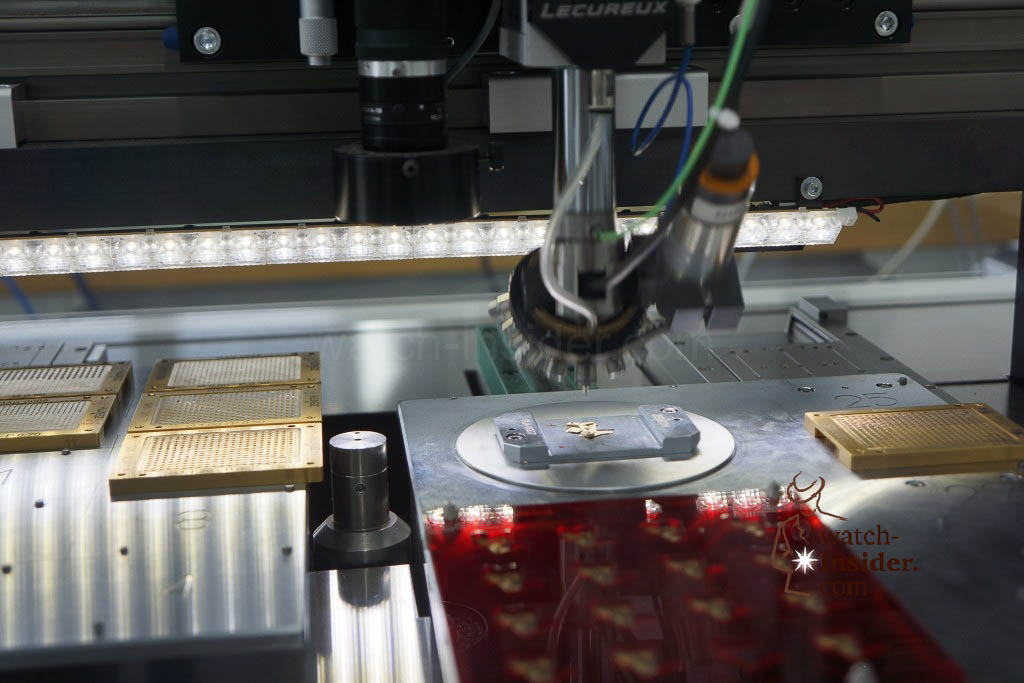 … this is the future: modern CNC-machines take over the work. The machine first picks up the jewels and then presses them with the exact defined force into the component or the main-plate…