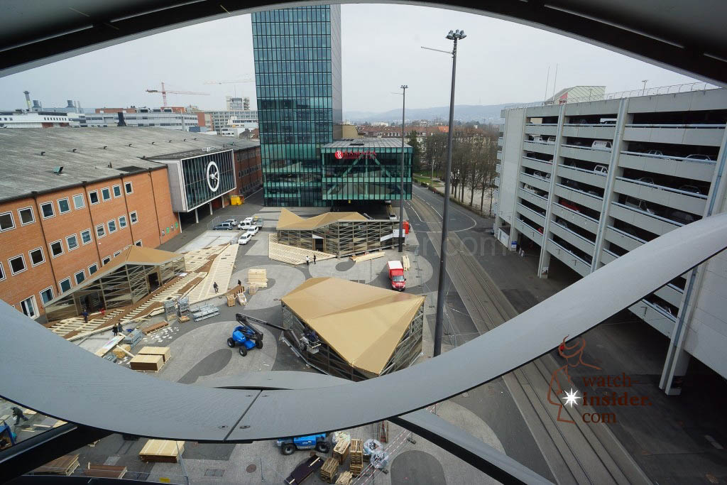Looking out of the window in hall 1.2. Left hall 2 in front the Ramada Hotel and right the covered car park with the press-center in the basement.