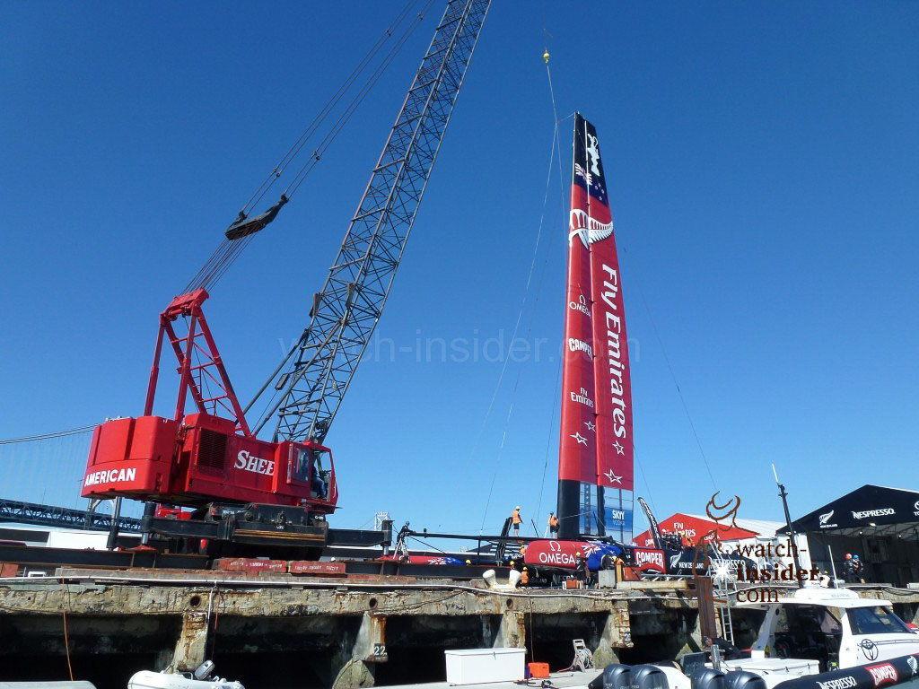 The ETNZ AC72 catamaran back at Pier 32 being lifted out of the water