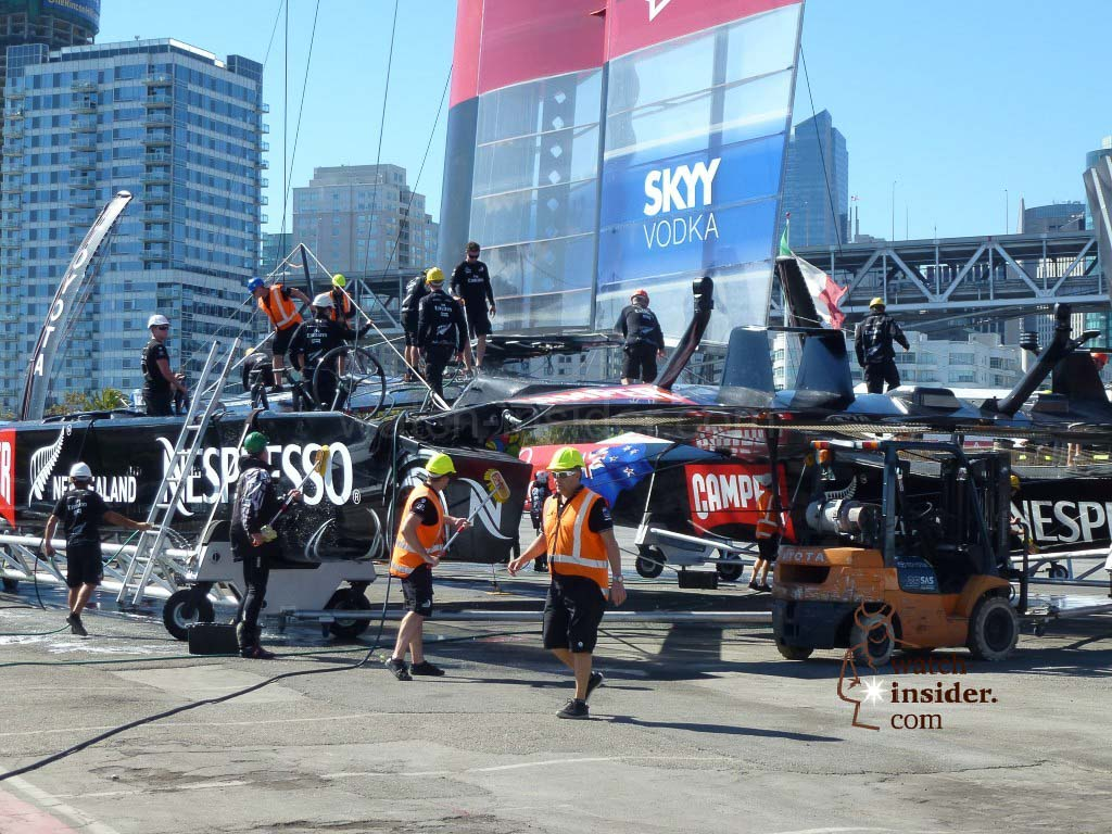 The ETNZ AC72 catamaran back at Pier 32 being being cleaned with sweat water