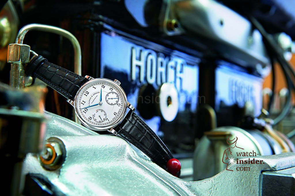 The A. Lange & Söhne 1815 Up/Down in white gold on a 1919 Horch four-cylinder engine (14/40 HP).