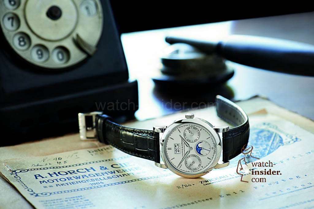 The A. Lange & Söhne Saxonia Annual Calendar and historical letters on the original writing desk of August Horch.