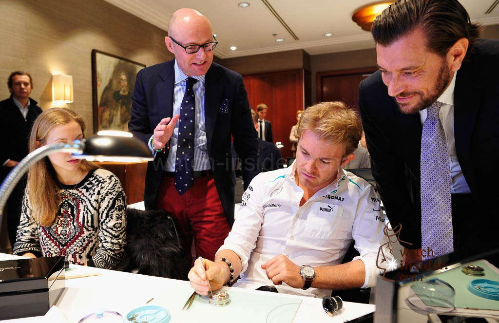 Georges Kern (L-R), CEO of swiss watch manufacturer IWC, Nico Rosberg and Henrik Ekdahl, Managing Director IWC Northern Europe attend a watchmaking class by IWC