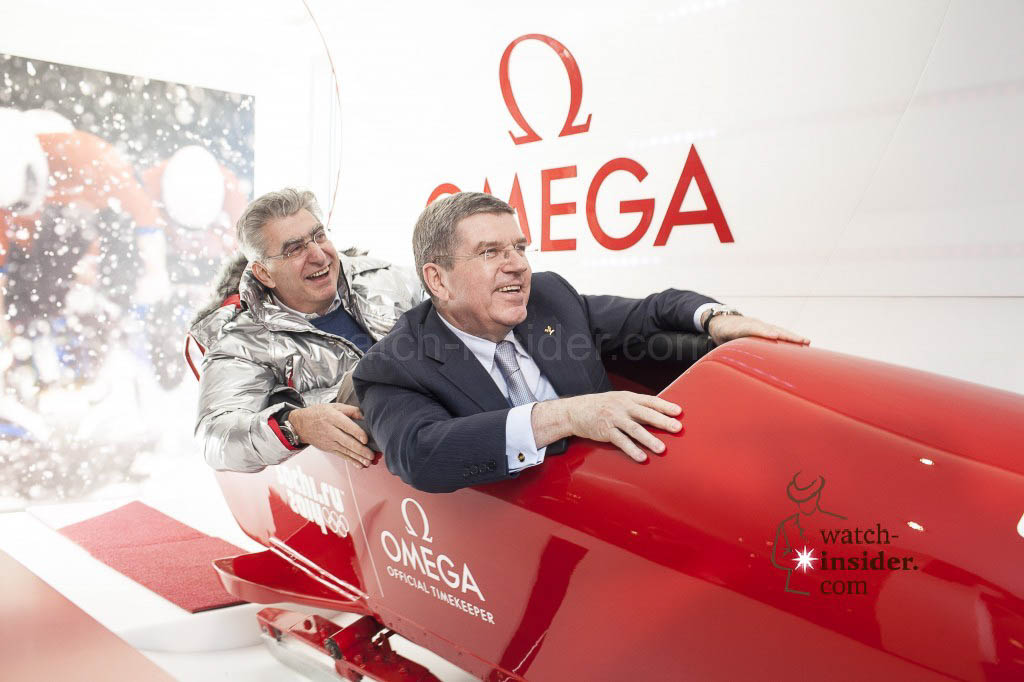 Swatch Group CEO Nick Hayek and IOC President Thomas Bach take a ride in the bobsleigh simulator at the OMEGA Pavilion in Sochi.