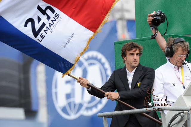 Formula 1 pilot Fernando Alonso waving the flag to officially start the 24 Hour of Le Mans race Saturday at 15:00 CET