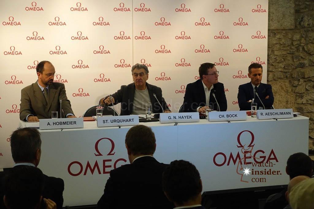 The Podium at todays press conference while Stephen Urquhart was speaking. Left Mr. Hobmeier, VP Omega Chief of Production Omega, Mr. Hayek, Mr. Bock President of METAS and Mr. Aeschlimann, VP Omega, head of sales.