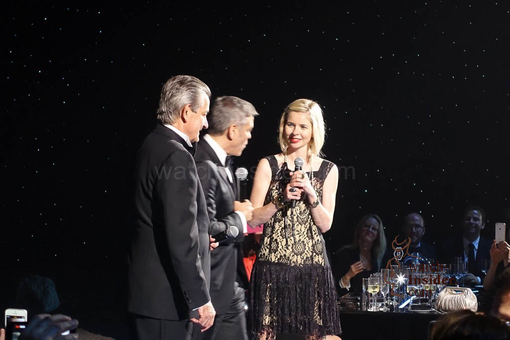 George Clooney at the Omega Speedmaster evening in Houston. He is being welcomed by Stephen Urquhart, President of Omega