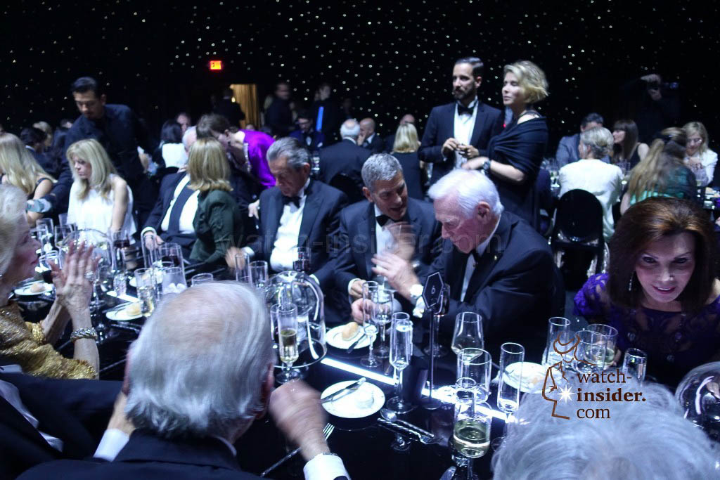 Left Stephen Urquhart, President of Omega, right George Clooney and Gene Cernan talking about watches