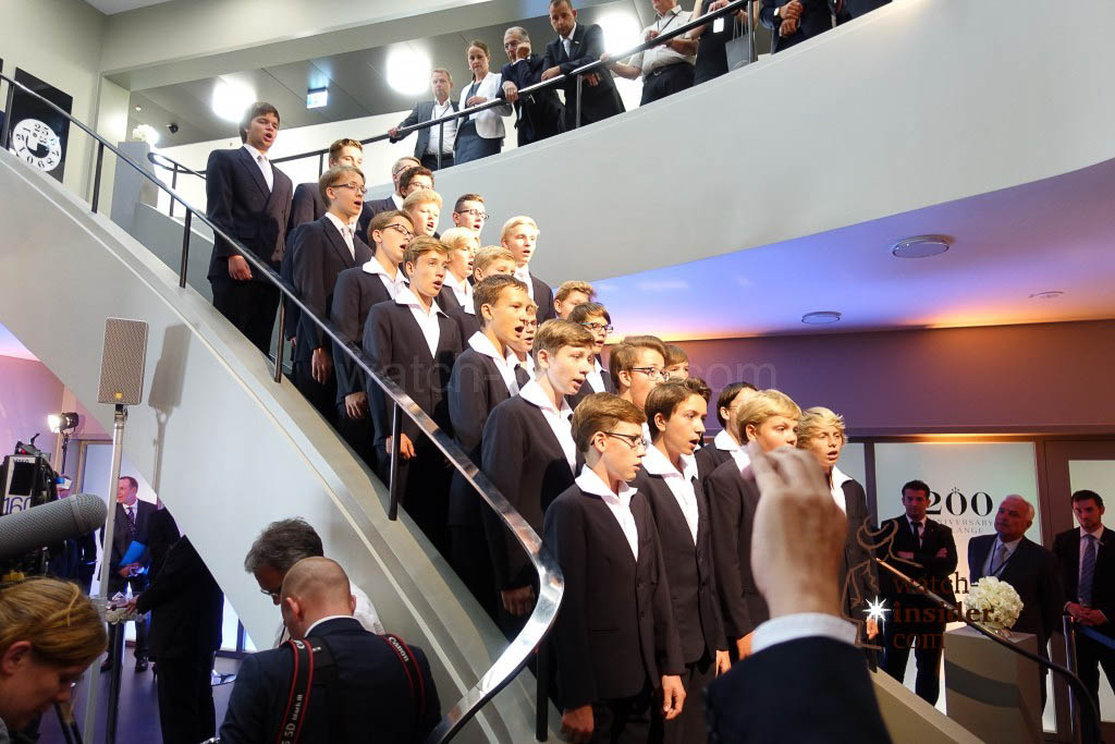 The German Chancellor Angela Merkel is welcomed by a boys choir