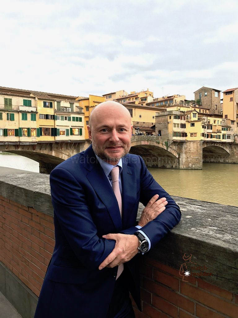 Georges Kern, CEO IWC Schaffhausen, standing in front of the famous Ponte Vecchio in Florence.